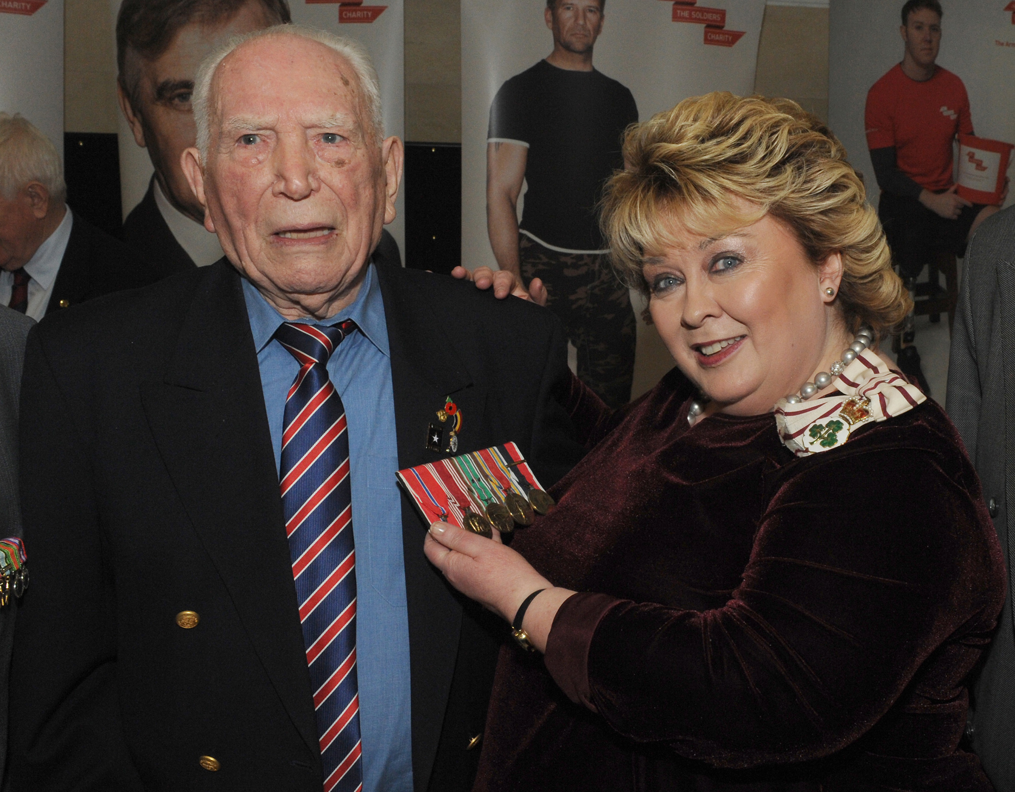 Fionnuala Jay-O'Boyle CBE (Lord Lieutenant of the County Borough of Belfast) pictured taking a close look at the medals of WW2 veteran Teddy Dixon at the WW2 Commemoration Concert 'Ulster at War' at the Waterfront Hall on Saturday 24th March. Teddy served with the US Army's 42nd Rainbow Division, 222nd Regiment Fox Company.